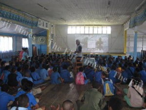 Children of Lomary listen intently as Manoa Rasigatale explains why the shark is important in our lives